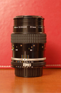 This is the Micro-Nikkor 55mm f/2.8 AI-s lens.  It's among the sharpest glass Nikon has ever made and is capable of razor-sharp pictures at close focus as well as great results in ordinary photography.  It is manual focus, so photography with this lens is slower, more deliberate, and more precise than when using any of the auto-focus lenses.  It would probably be my last choice for taking action shots at a sporting event.  The lens is capable of 1:2 life-size reproduction, and with the PK-13 extension tube, 1:1 life-size reproduction.  It is compatible with almost every Nikon camera, from the Nikon F all the way to the Nikon D300 and D3 cameras.  Examples of pictures from this lens:   Closeup of Miles. Closeup of Asanuma 135mm f/2.8 lens.