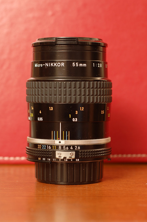 "This is the Micro-Nikkor 55mm f/2.8 AI-s lens.  It's among the sharpest glass Nikon has ever made and is capable of razor-sharp pictures at close focus as well as great results in ordinary photography.  It is manual focus, so photography with this lens is slower, more deliberate, and more precise than when using any of the auto-focus lenses.  It would probably be my last choice for taking action shots at a sporting event. <p><p> The lens is capable of 1:2 life-size reproduction, and with the PK-13 extension tube, 1:1 life-size reproduction.  It is compatible with almost every Nikon camera, from the Nikon F all the way to the Nikon D300 and D3 cameras. <p><p> Examples of pictures from this lens: <p> <ul> <li><a href=""http://therion256.smugmug.com/gallery/639789/2/59350323/Large"">Closeup of Miles.</a> <li><a href=""http://therion256.smugmug.com/gallery/677801/1/63890698/Large"">Closeup of Asanuma 135mm f/2.8 lens.</a> </ul> <p>"