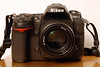 """My Nikon D300<br /> <br /> This is my principal camera, the Nikon D300. It exists in the professional DX/APS-C sensor-sized camera line. This lineage consists of the Nikons D100, D200 and D300. The D100 was the original prosumer/pro camera introduced in 2002 with many decidedly pro features, based on the N80 film body. The D70 was subsequently introduced as the """"Canon Digital Rebel Killer"""" in 2004, and as their consumer camera of the time, did feature some improvements over the D100, but fewer controls on the body. The D200 came out in 11/2005, still as a semi-pro camera, now in a magnesium-alloy body, as befitting semipro/pro bodies. Now with the D300, Nikon has split this camera line and the D3 into their pro line, and they've filled in their consumer line (D40(x)/D50/D60) and prosumer lines (D80 and D200, still in production as of 3/27/08) nicely. The D300 replaces the Nikon D2x for those who wish to remain with the DX format. Nikon starts the full-frame sensor line with the D3, hopefully with other full-frame bodies at various price points (such as the price point of this camera) forthcoming.<br /> <br /> The 12.3 megapixel D300 features a DX/APS-C sized CMOS sensor (23.6 x 15.8mm), which greatly improves power consumption over previous Nikon DSLR models, as CCD sensors have higher power requirements. One caution for those who perform """"wet"""" cleans of their sensor: You'll need to switch from Eclipse solution to their E2 solution, as this sensor uses indium tin oxide, which is vulnerable to damage from a pure methanol solution such as Eclipse. I've never personally had to perform a wet clean, and have only manually cleaned using the Copperhill SensorSweep dry-brush method. This body is Nikon's first to feature self-cleaning by rapidly vibrating the AA filter to shake off dust, so perhaps the number of dry brush cleans I do (not that many) will be reduced. ISO signal-to-noise ratio has been improved some more in this model, and I would not hesitate to go above ISO """