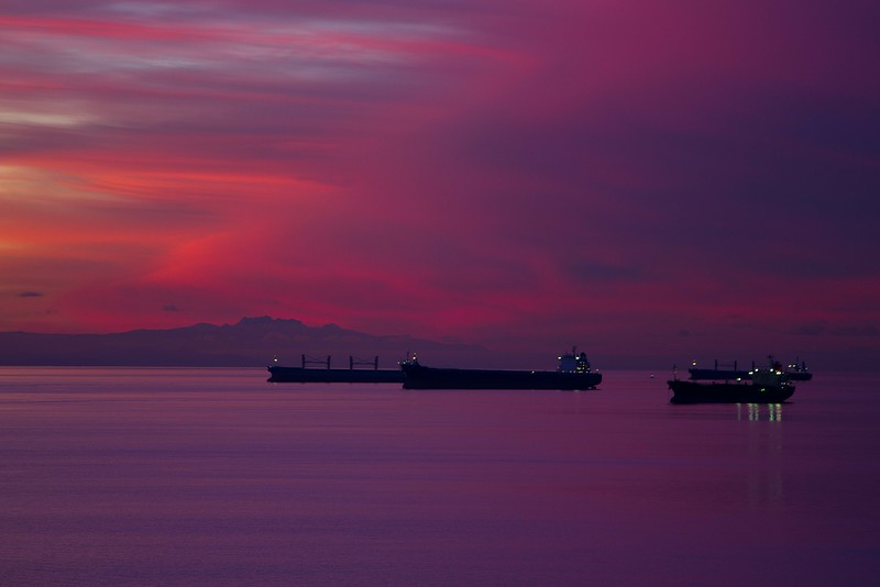 Ships lined up off English Bay in Vancouver.<br /> Photo © Carl Clark