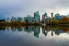 Vancouver viewed across Lost Lagoon on a still autumn afternoon.<br /> Photo © Carl Clark