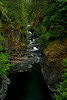 A verdant, narrow gorge at Englishman River Falls Trail, Vancouver Island, B.C.<br /> Photo © Cindy Clark