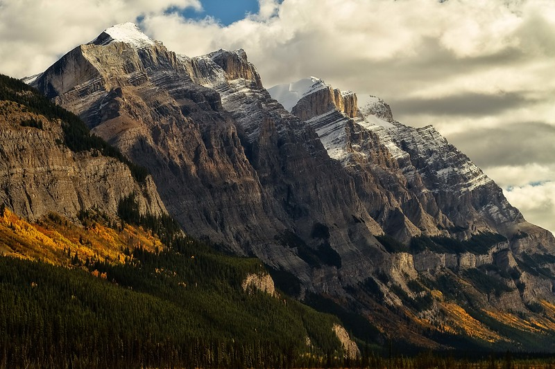 Autumn colors adorn the lower slopes of Mt Wilson in the Canadian Rockies.<br /> Photo © Carl Clark
