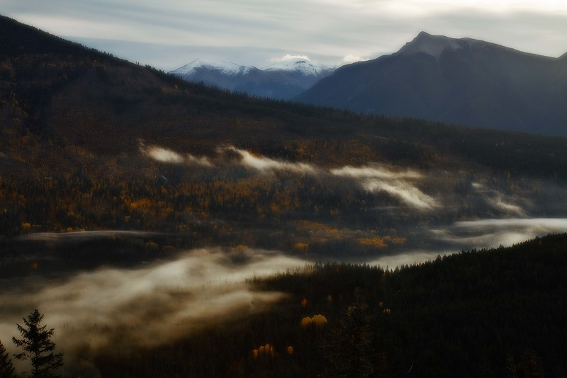 Lingering morning fog over the Kootenay River in British Columbia.<br /> Photo © Carl Clark