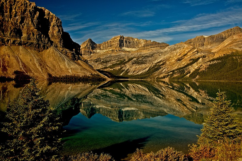 Mt Thompson reflected in the still waters of Bow Lake in the Canadian Rockies.<br /> Photo © Carl Clark