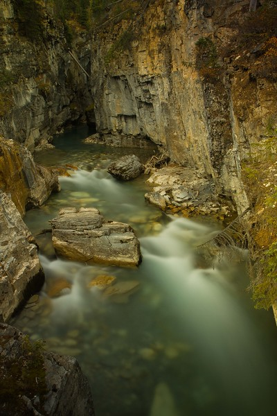 Tokumm Creek flows through the walls of Marble Canyon in the Canadian Rockies.<br /> Photo © Carl Clark