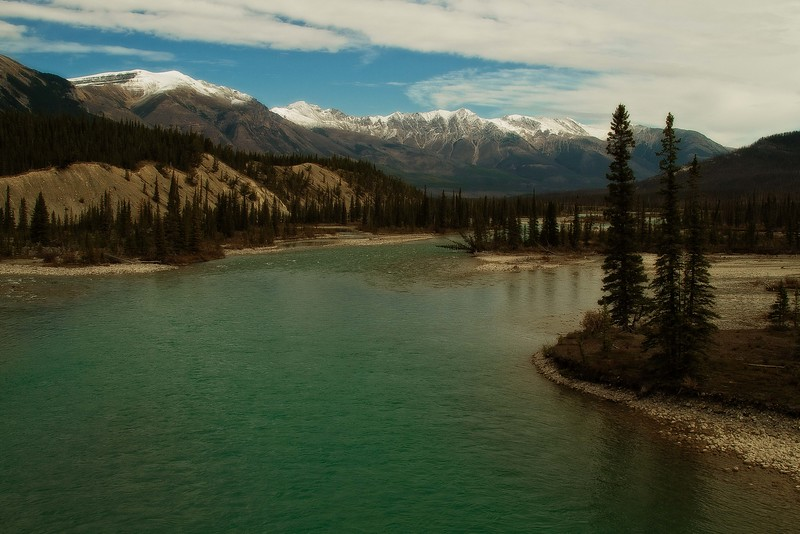 The Saskatchewan River flows through the Canadian Rockies.<br /> Photo © Carl Clark
