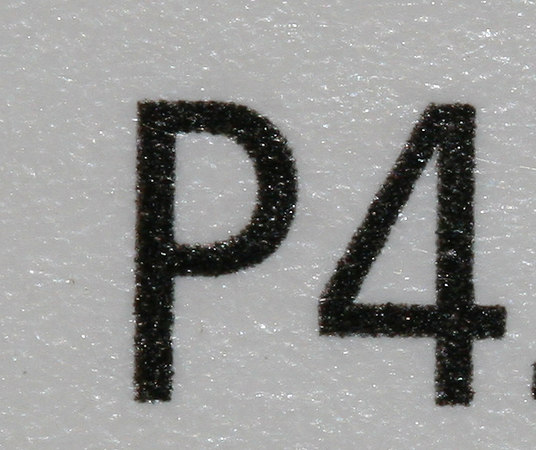 "100% Crop - ""P"" is 1.5mm wide x 2mm tall"