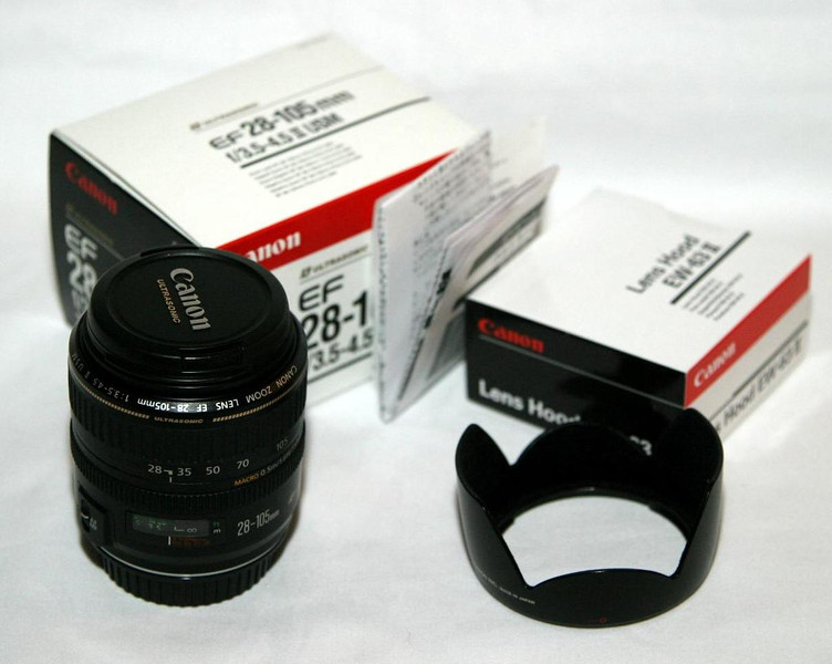 Canon EF 28-105mm F3.5-4.5 -- My first real lens.  A good balance of price and quality and definitely a good choice when I had my photography hobby relaunch around 2001.  It was my primary lens on my old EOS Rebel and early on for my Canon 10D.