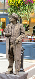 Busker of James Joyce (right next to a real statue)