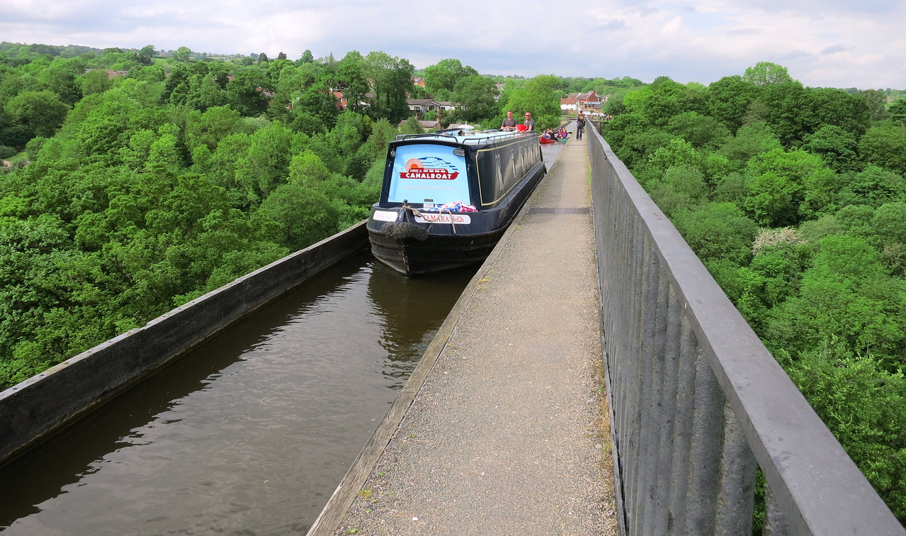 Aqueduct The Pontcysyllte Aqueduct is a navigable aqueduct that carries the Llangollen Canal over the valley of the River Dee in Wrexham in north east Wales. Completed in 1805, it is the longest and highest aqueduct in Britain, a Grade I Listed Building and a World Heritage Site.
