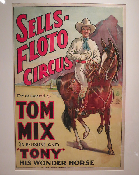 Tom Mix poster. John's childhood idol; he got to sit on Tony when he was about five years old.