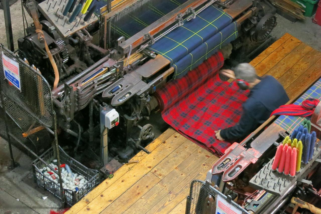 tartan weaving - beautiful but really noisy machines!