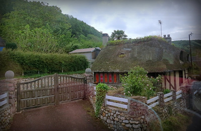 Thatched roof cottage - guide took us along a scenic route to Honfleur