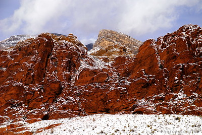 """Snow at Calico Hills"" ~ Snow at Calico Hills within Red Rock Canyon, Nevada.  Turtlehead Peak appears in the center behind the red rocks."