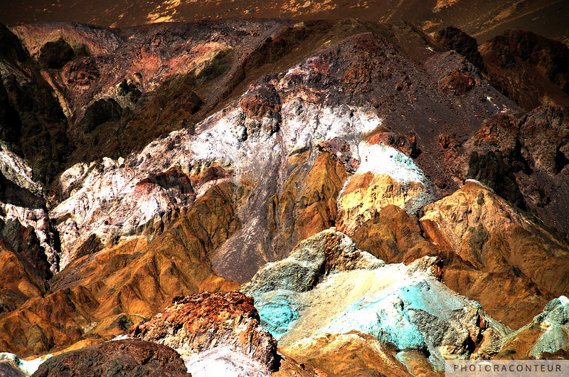 """""""Artist Palette, Death Valley"""" ~ Colorful mountains within Death Valley National Park.  These colors are caused by the oxidation of different metals (red, pink and yellow is from iron salts, green is from decomposing tuff-derived mica, and manganese produces the purple). Called the Artist Drive Formation, the rock unit provides evidence for one of the Death Valley area's most violently explosive volcanic periods. The Miocene-aged formation is made up of cemented gravel, playa deposits, and much volcanic debris, perhaps 5,000 feet thick.  Chemical weathering and hydrothermal alteration are also responsible for the variety of colors displayed at Artist Palette."""