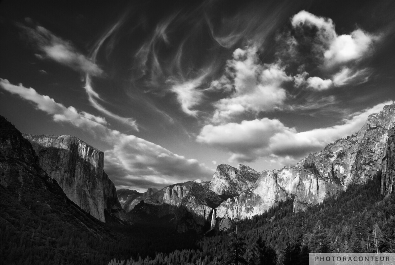 """Yosemite Valley Cloudscape (B&W)"" ~ View of majestic Yosemite Valley from Inspiration Point near sunset. The view includes El Capitan, Half Dome, and Bridalveil Falls."