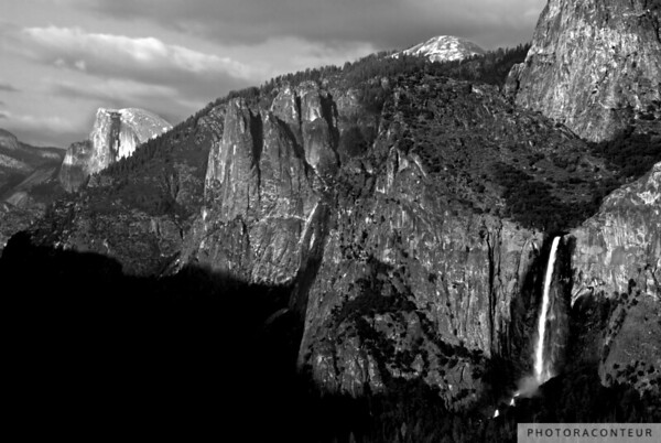 """Bridalveil Fall & Half Dome"" ~ View of Bridalveil Fall and Cathedral Rocks along with Half Dome in Yosemite National Park.  The 620' tall waterfall was originally named ""Pohono"" by Native Americans, which translates to ""the spirit of the puffing wind""."