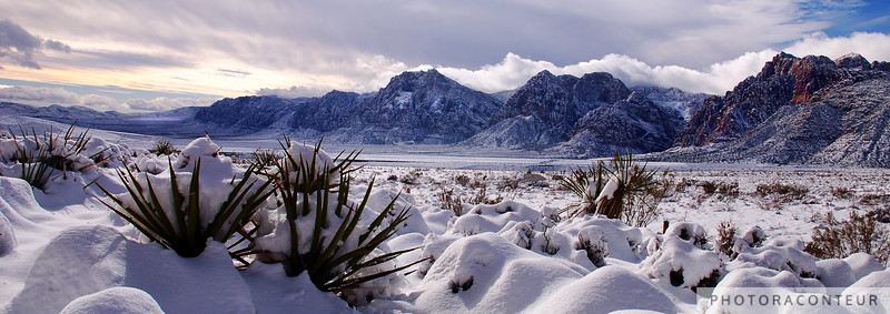 """Red Rock Snow, Panoramic No. 3"" ~ Snow covered mountain range and valley within Red Rock Canyon, Nevada.  The photo has been cropped to focus on the mountains and valley and to simulate the aspect ratio of panoramic film cameras such as the Linhof Technorama 617s."