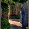 HDR image. I liked the ghosting. Even though the focus was on the gate, the ghosting made it interesting.
