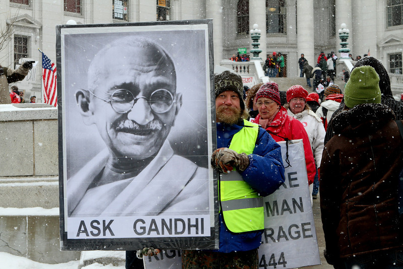 "Ask Gandhi - a reminder of the power of non-violent protest in changing the fortunes of people around the world.  Capital police stated  ""We've had no problems"" and they were committed to keeping the Square ""safe for democracy""."