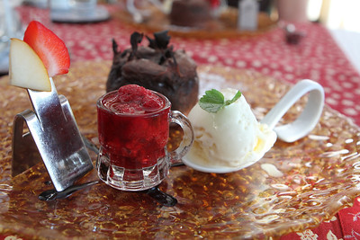 Raspberries with a chocolate fondant with ice cream.  The chocolate is baked hot inside its own edible cake - just lovely.