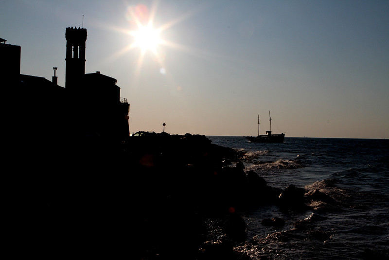 The Punta Lighthouse as the day slowly ends -- waves from the Gulf of Trieste reach the shore