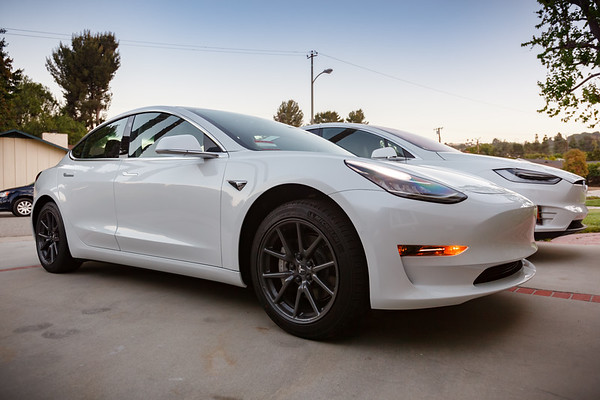Hers and his Teslas from the driveway