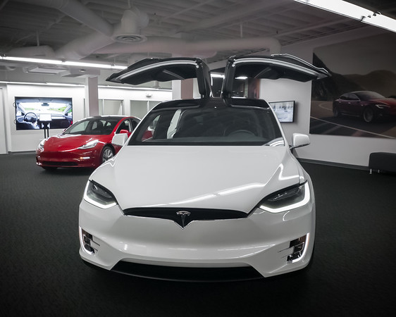 They have a red Model 3 and a white Model X on display.  Valerie prefers the seats in this X over mine...because this one's middle row folds flat and the backs are no longer glossy