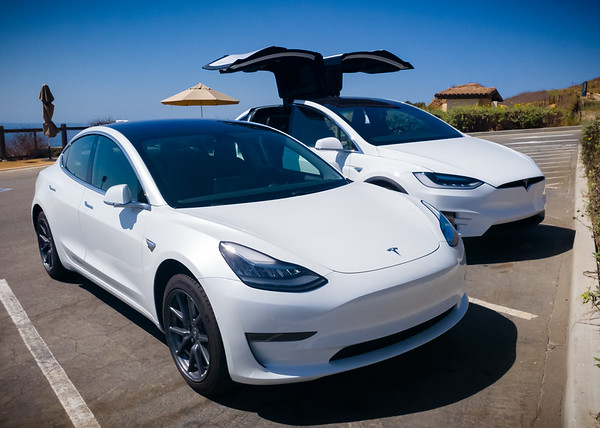 I keep thinking that maybe, just maybe we should move both of our cars to the other side of the lot...so we can get more of the ocean in my shots #Tesla #Model3 #ModelX #HersAndHis #NationalDriveElectricWeek