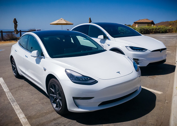 This is one of those rare opportunities for us to get a photo of our Teslas parked together away from home.  Actually, we have more photos of this pair away from home than any of our previous cars. #Tesla #Model3 #ModelX #HersAndHis #NationalDriveElectricWeek