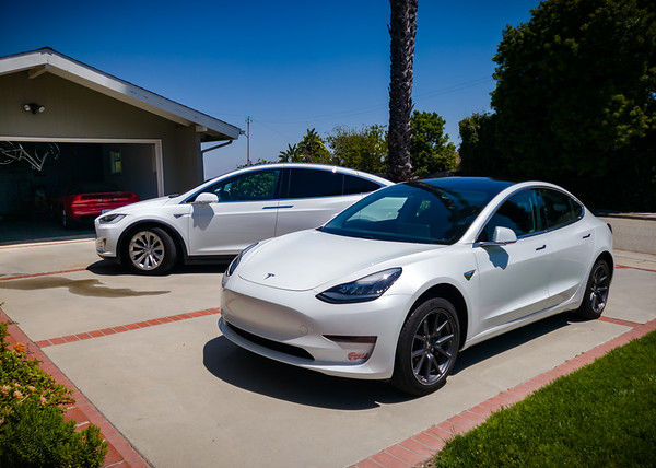 """Rare moment we have both of our Teslas on the driveway since the """"Safer at Home"""" thing began.  I haven't had much reason to drive Model X, but Valerie continues to borrow it for her shopping trips (which means her car usually stays covered)."""