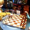 Kids Playing Chess in Store in Newport Beach California