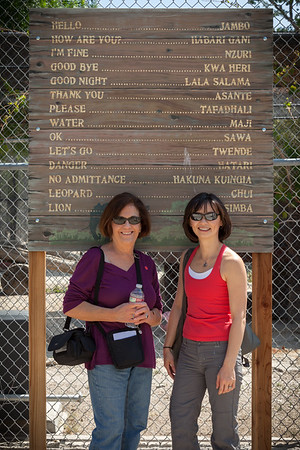 "Mom and Valerie wait to enter Shambala.  I think all of us looked to see if ""Hasa Diga Eebowai"" was on this sign."