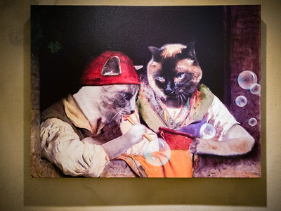 Hey, the cats in this painting look familiar!