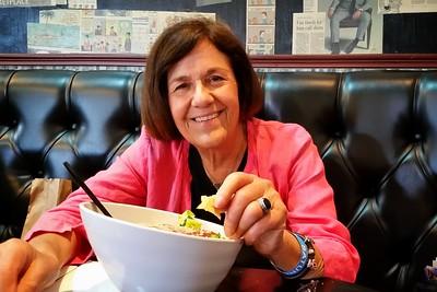 Mom enjoys a salmon caesar salad