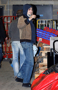 Pete Docherty of Babyshambles arrives at the rear entrance of Digital nightclub, Newcastle upon Tyne where he was to perform an acoustic set, he had been due to appear previously but was arrested in London and failed to appear. 22 February 2006