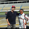 Racing icon Mario Andretti and I at Lowes Motor Raceway at the time now known as Charlotte . It was a track day and a meet and greet .