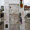 Tomb of Marie Leveau, the Voodoo queen. Still visited by Voodoo lovers.