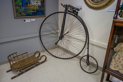 Child's sled and a Penny Farthing Bicycle - Jefferson County Museum