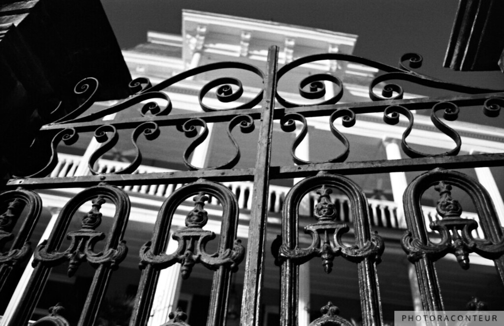 """South Battery Gated Mansion"" ~ B&W composition of historic mansion behind wrought iron gate in Charleston, South Carolina.   A sepia toned vignette is available in my ""Charleston in Sepia"" gallery."