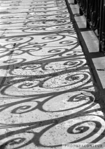"""Shadow Swirls No. 1, Old Exchange"" ~ B&W composition of swirls crated by the shadows of wrought iron at the Old Exchange building in historic Charleston, SC."