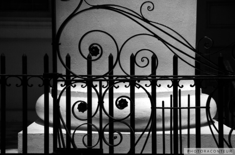 """St. Johannes Iron & Columns"" ~ B&W composition of iron gate, iron fence, and column at the St. Johannes Lutheran Church in historic Charleston, SC."