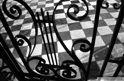 """St. Matthew's Iron Gate"" ~ B&W composition, almost musical, of the iron gate and marble tiles at the St. Matthew's Lutheran Church in historic Charleston, South Carolina."
