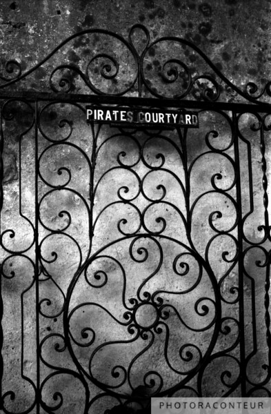 """Pirates Courtyard"" ~ B&W composition of the Pirates Courtyard wrought iron gate, located across from St. Philips in historic Charleston, SC."