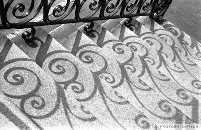 """Shadows & Stairs No. 2"" ~ Shadows created by iron balusters at the Old Exchange Building in historic Charleston, SC.  Shot on Kodak T-MAX B&W film."