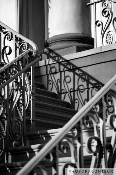 """""""Market Hall, Charleston, SC"""" ~ Historic downtown Charleston in South Carolina has one of the highest concentrations of  finely crafted iron fences and gates in the world. While most of the ironwork is of the wrought iron variety, there is also some amazing cast iron installed around the city.  It was a great pleasure to live in Charleston while the old Market Hall (c. 1841) was being renovated, including the beautiful ornate cast iron balusters and railing on its façade.  It was so cool to see the old cast iron come back to life up the double winding staircase entrance to the building, and it was even cooler to capture a fun composition."""
