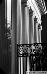 """Hibernian Iron & Columns No. 4"" ~ Photo of wrought iron gate and ionic columns at Hibernian Hall in historic Charleston, SC."