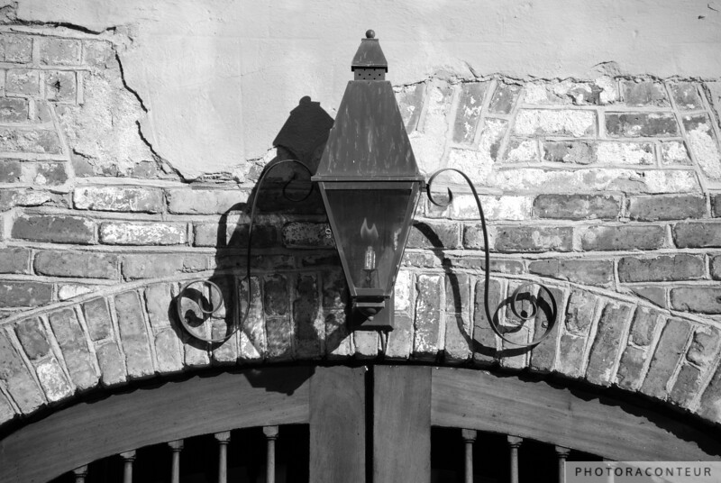 """""""Queen Street Gas Lamp No. 1"""" ~ Composition of gas lamp above a garage in historic Charleston, SC.  Also available in color and sepia tone."""