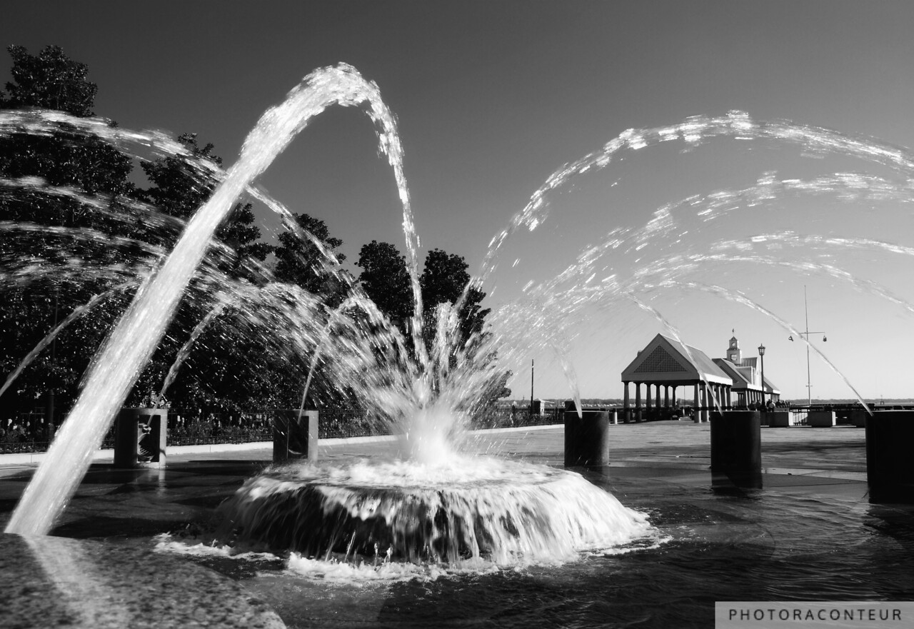 """Waterfront Fountain"" ~ A focal point of family activity in the beautifully appointed Waterfront Park in downtown Charleston, South Carolina, this fountain is usually filled with kids splashing about in swimsuits, while their parents retreat from the sun under nearby shade trees.  I arrived early one chilly February morning in order to capture this photo, sans children.  The arching streams of water frame the park's pier as well as Patriot's Point on the opposite shore of Charleston Harbor.    NOW AVAILABLE: 16""x24"" MetalPrints in Limited Editions of 100. Click for more info:      HUGE PRINTS are also available for this photo! Get prints that are taller than you are, or wider than you can stretch your arms! Click for more info:"